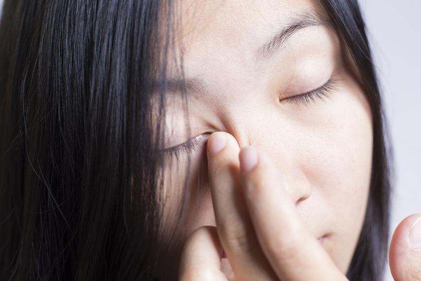 49544150 - woman rubbing her eye