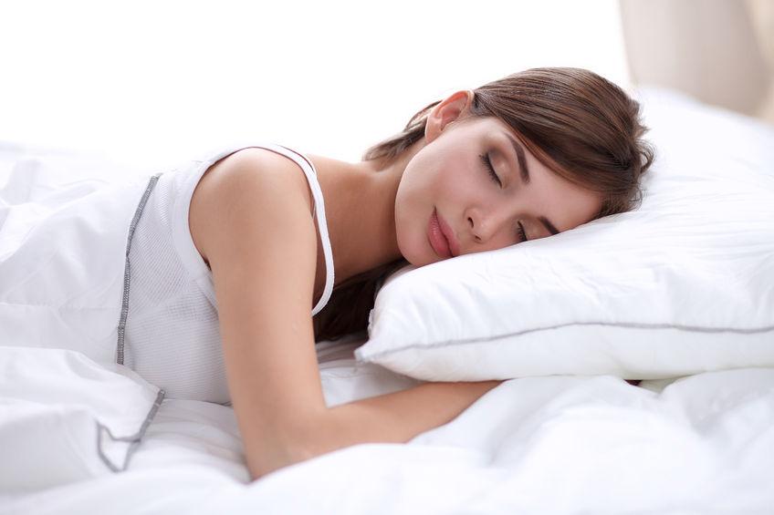 42534943 - beautiful girl sleeps in the bedroom, lying on bed, isolated