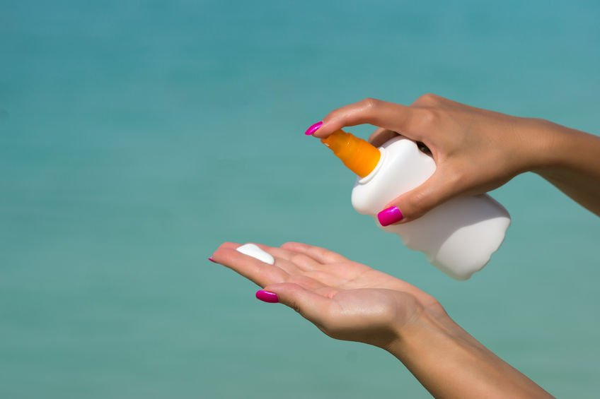 woman applying zinc oxide sunscreen