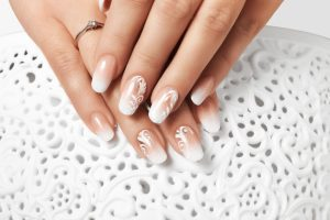 Manicure and white abstract pattern on women's nails