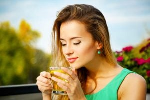 woman enjoying aroma of tea | Beverly Hills MD