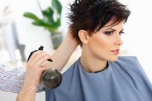 woman at hair stylist with short bob haircut