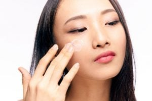 woman applying moisturizer | Beverly Hills MD