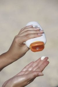squeezing sunscreen into hand | Beverly Hills MD