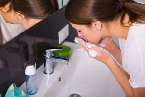 woman washing face   Beverly Hills MD