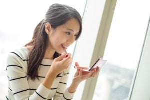 woman applying lipstick   Beverly Hills MD