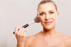 woman applying blush   Beverly Hills MD